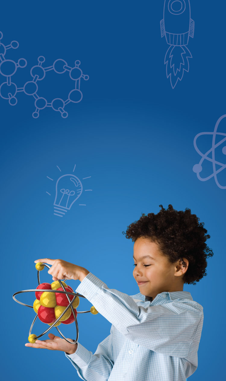 Boy in a lab coat holding an atom